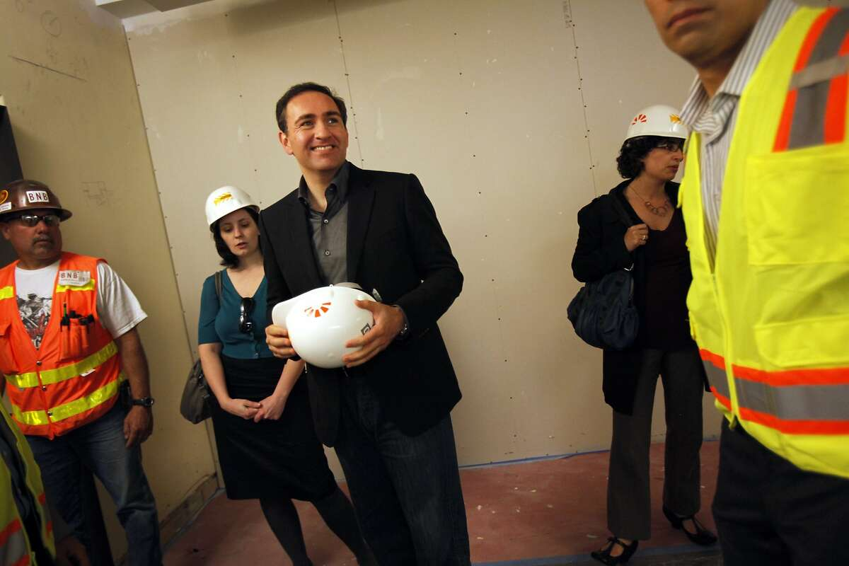 Twitter CFO Ali Rowghani, center, tours the SF Furniture Mart building, which is under renovations to become Twitter's offices in San Francisco, Calif., Thursday, May 10, 2012. One of Mayor Lee's first policy decisions was pushing a tax break for the downtrodden Mid-Market area to keep Twitter Inc. from leaving the city.