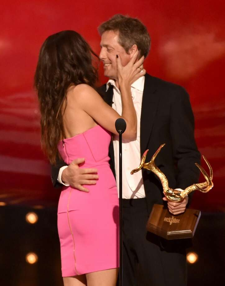 "Actress Sandra Bullock accepts the Decade of Hotness award from actor Hugh Grant onstage during Spike TV's ""Guys Choice 2014"" at Sony Pictures Studios on June 7, 2014 in Culver City, California. Photo: Kevin Winter, Getty Images For Spike TV"