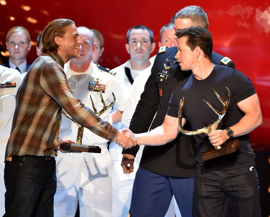 "Actor Mark Walhberg (R) accepts the Troops Choice award from actor Charlie Hunnam onstage during Spike TV's ""Guys Choice 2014"" at Sony Pictures Studios on June 7, 2014 in Culver City, California. Photo: Kevin Winter, Getty Images For Spike TV"