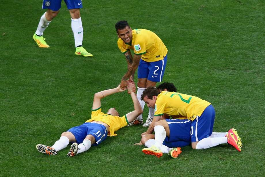 Oscar of Brazil celebrates his goal with Dani Alves and Bernard of Brazil in the second half during the 2014 FIFA World Cup Brazil Group A match between Brazil and Croatia at Arena de Sao Paulo on June 12, 2014 in Sao Paulo, Brazil. Photo: Elsa, Getty Images