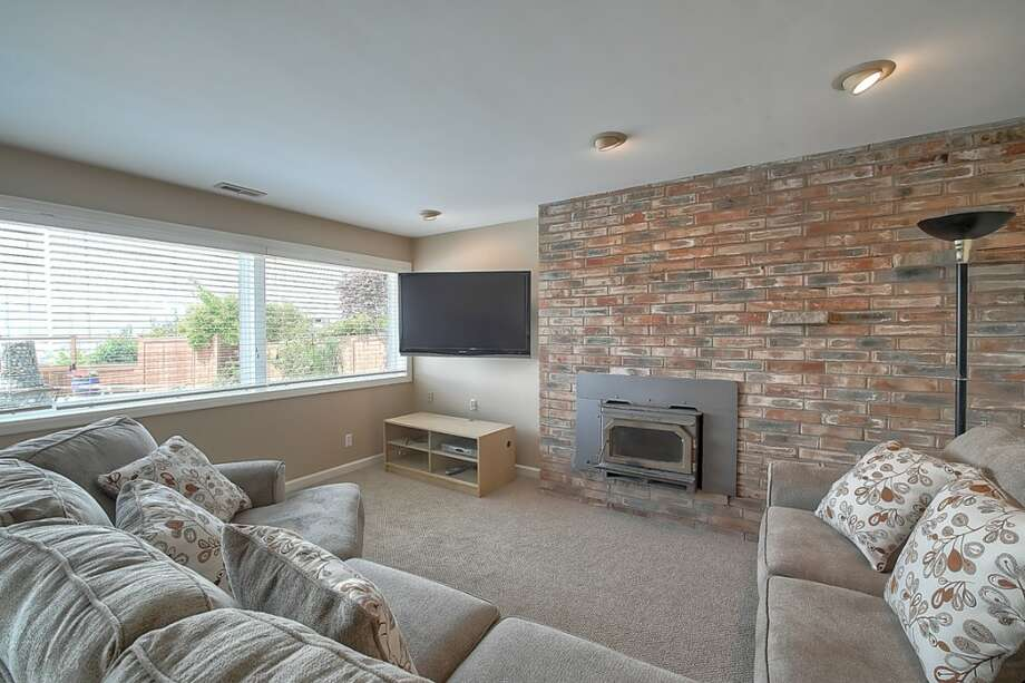 We'll start with 3615 57th Place S.W., which has a daylight family room with a fireplace that could double as a TV wall. Photo: Walk Through Media, Courtesy Scott Henry/John L. Scott Real Estate