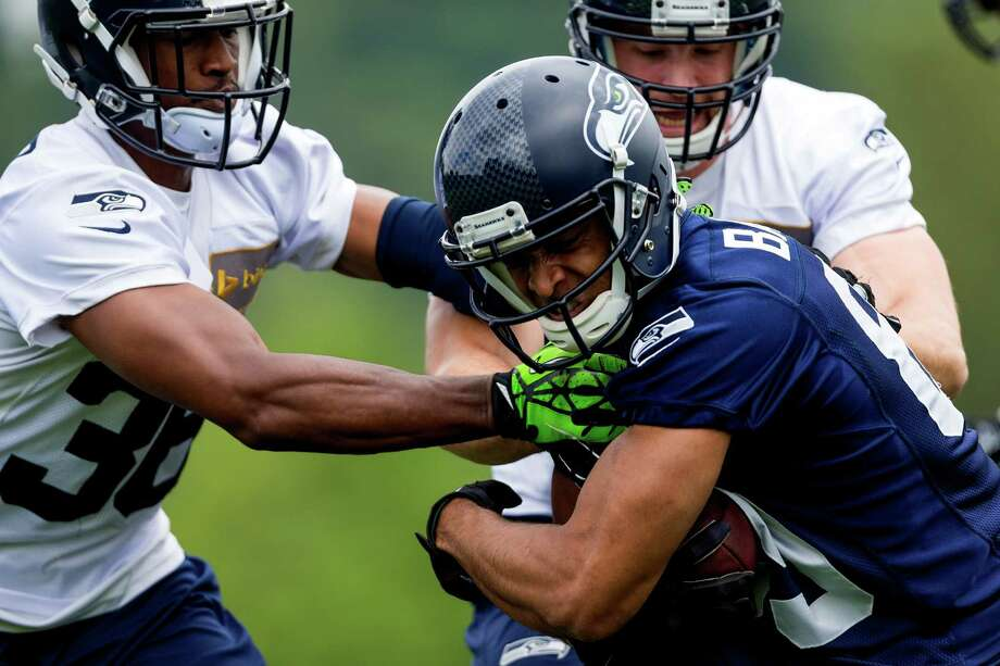 Seahawks player Doug Baldwin, center, pushes through teammates while running drills on the ninth and final day of Organized Team Activities Thursday, June 12, 2014, at the Virginia Mason Athletic Center in Renton, Wash. Photo: JORDAN STEAD, SEATTLEPI.COM / SEATTLEPI.COM