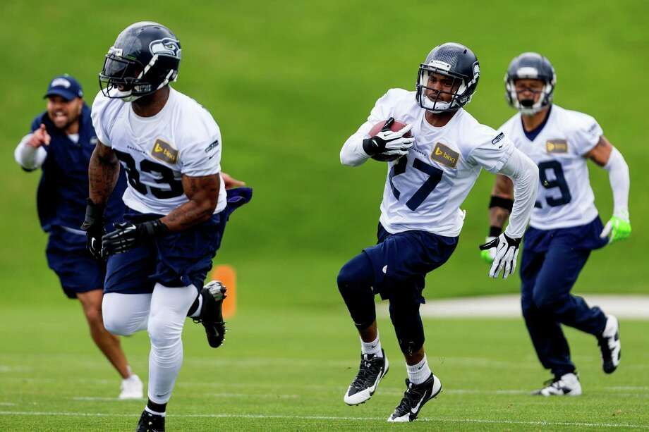 Seahawks players run drills on the ninth and final day of Organized Team Activities Thursday, June 12, 2014, at the Virginia Mason Athletic Center in Renton, Wash. Photo: JORDAN STEAD, SEATTLEPI.COM / SEATTLEPI.COM