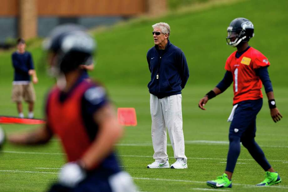 Seahawks head coach Pete Carroll watches his players run drills on the ninth and final day of Organized Team Activities Thursday, June 12, 2014, at the Virginia Mason Athletic Center in Renton, Wash. Photo: JORDAN STEAD, SEATTLEPI.COM / SEATTLEPI.COM