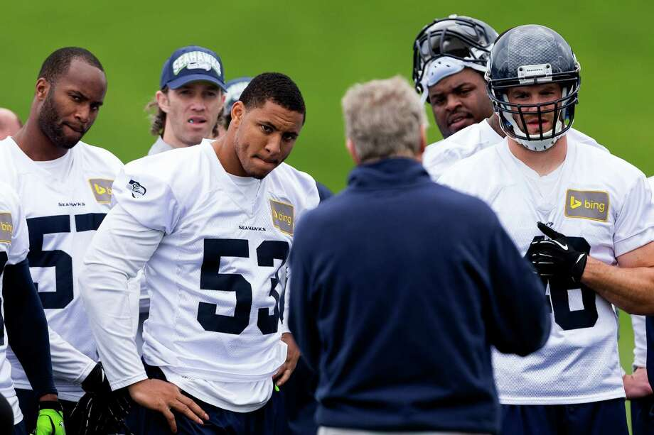 Seahawks players listen to head coach Pete Carroll, center, on the ninth and final day of Organized Team Activities Thursday, June 12, 2014, at the Virginia Mason Athletic Center in Renton, Wash. Photo: JORDAN STEAD, SEATTLEPI.COM / SEATTLEPI.COM