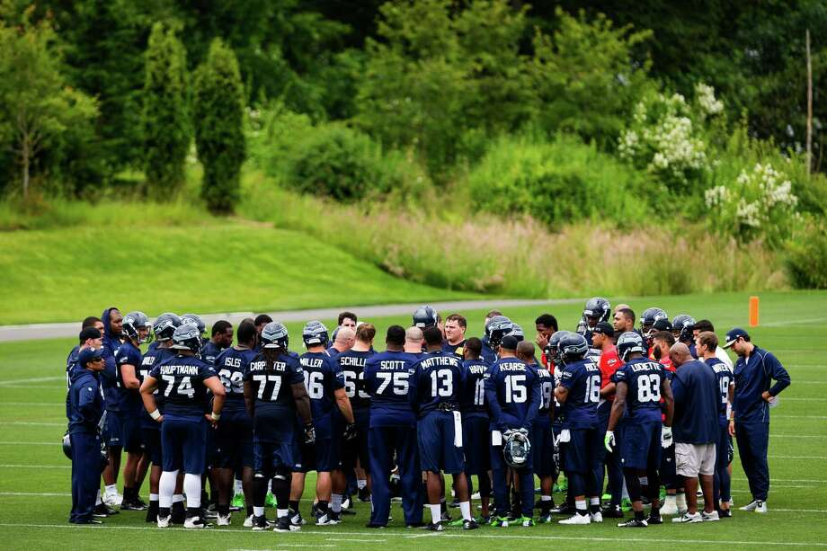 Seahawks players huddle up on the ninth and final day of Organized Team Activities Thursday, June 12, 2014, at the Virginia Mason Athletic Center in Renton, Wash. Photo: JORDAN STEAD, SEATTLEPI.COM / SEATTLEPI.COM