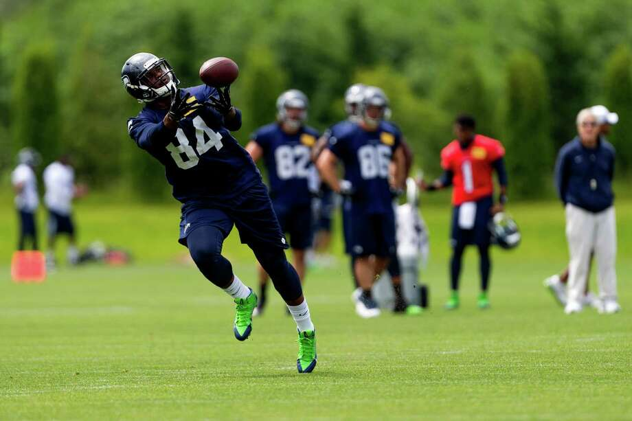 Seahawks player RaShaun Allen reaches for a catch on the ninth and final day of Organized Team Activities Thursday, June 12, 2014, at the Virginia Mason Athletic Center in Renton, Wash. Photo: JORDAN STEAD, SEATTLEPI.COM / SEATTLEPI.COM