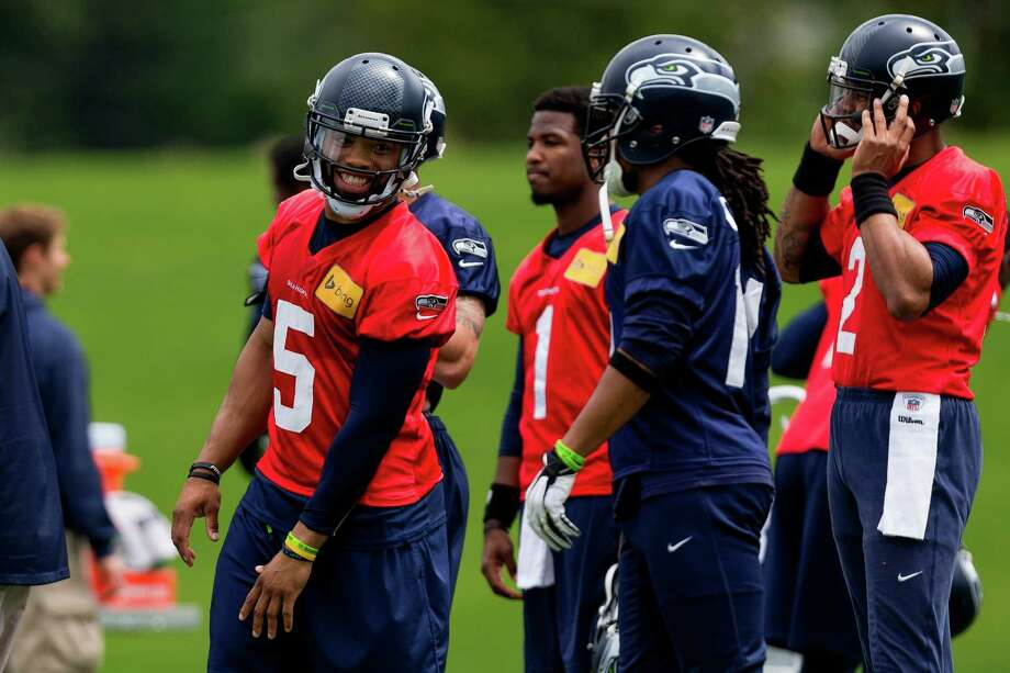 B.J. Daniels, left, laughs with other Seahawks players on the ninth and final day of Organized Team Activities Thursday, June 12, 2014, at the Virginia Mason Athletic Center in Renton, Wash. Photo: JORDAN STEAD, SEATTLEPI.COM / SEATTLEPI.COM