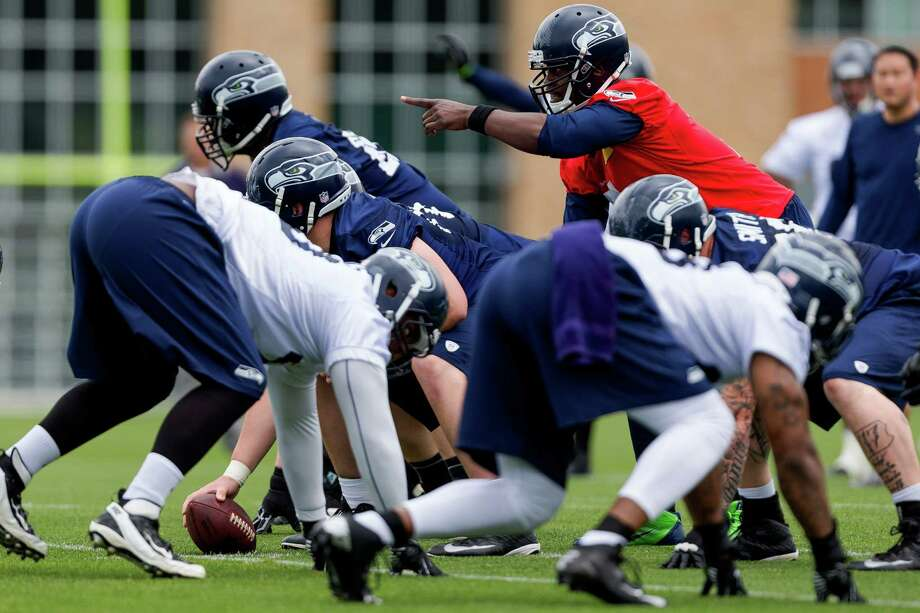 Seahawks' quarterback Tarvaris Jackson, right, calls for a play on the ninth and final day of Organized Team Activities Thursday, June 12, 2014, at the Virginia Mason Athletic Center in Renton, Wash. Photo: JORDAN STEAD, SEATTLEPI.COM / SEATTLEPI.COM