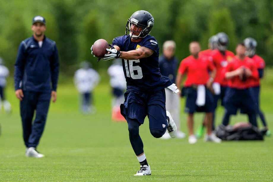Seahawks player Taylor Price reaches for a catch on the ninth and final day of Organized Team Activities Thursday, June 12, 2014, at the Virginia Mason Athletic Center in Renton, Wash. Photo: JORDAN STEAD, SEATTLEPI.COM / SEATTLEPI.COM