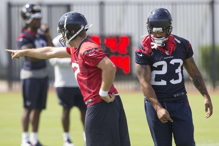 Day 9 - June 12  Case Keenum (7) calls a play with running back Arian Foster (23) moving into position. Photo: Brett Coomer, Houston Chronicle