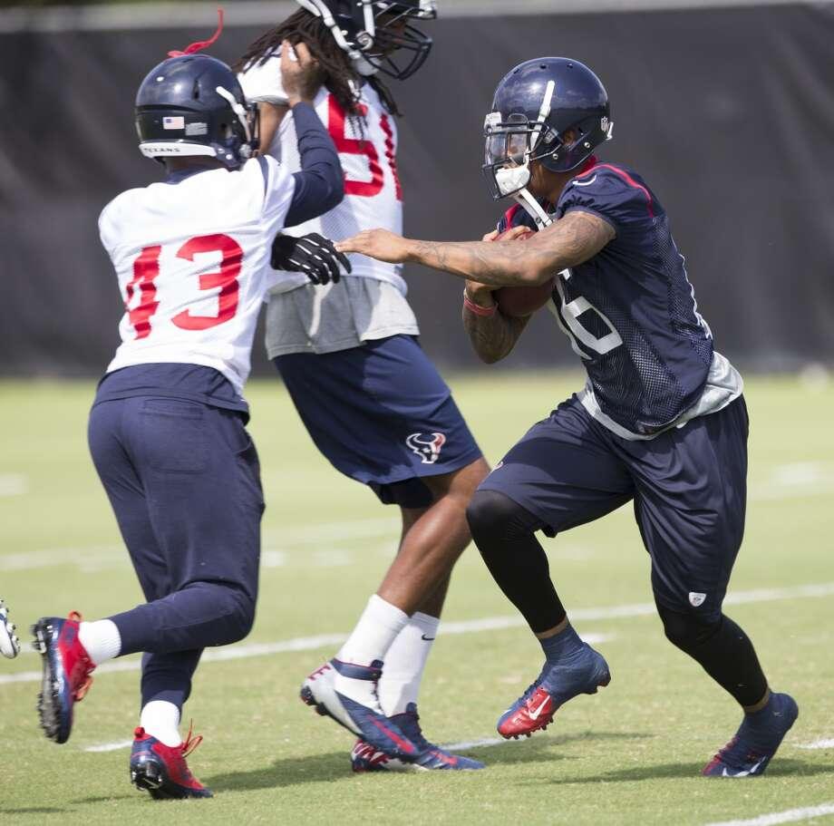 Texans wide receiver Alan Bonner (16) cuts back across the field past the block of Elbert Mack (43). Photo: Brett Coomer, Houston Chronicle
