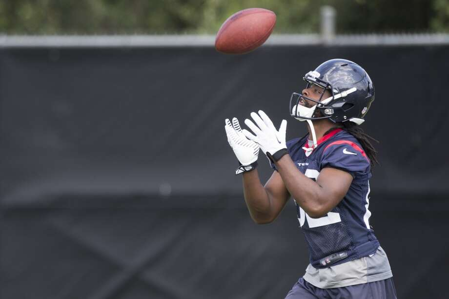 Texans wide receiver Keyshawn Martin fields a kick during a special teams drill. Photo: Brett Coomer, Houston Chronicle
