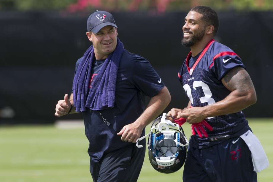 Texans head coach Bill O'Brien, left, jogs across the field with running back Arian Foster. Photo: Brett Coomer, Houston Chronicle