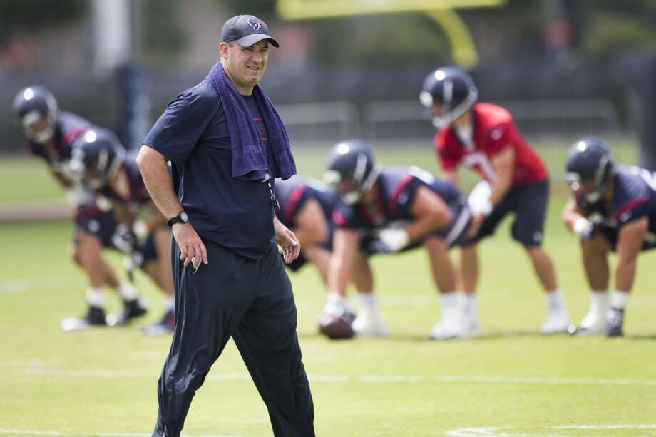 Bill O'Brien walks across the field. Photo: Brett Coomer, Houston Chronicle