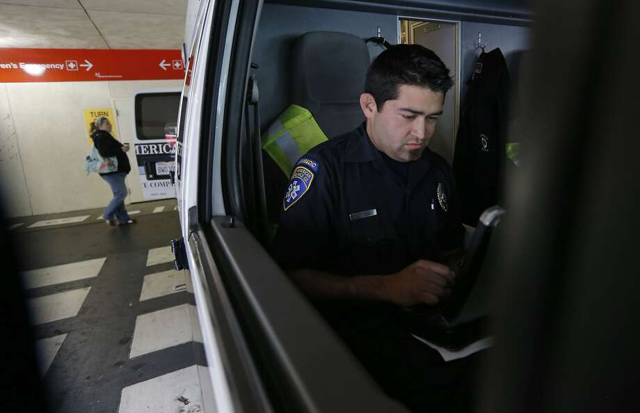 Paramedic Cory Yeo with the King-American Ambulance company completes paperwork after transporting a patient to UCSF medical center, on Thursday 12, 2014, in San Francisco, Calif. A report by the budget analyst reports the city needs to increase its ambulance staffing, improve its emergency system coordination and 911 dispatch system and replace its aging ambulance fleet. Photo: Michael Macor, The Chronicle