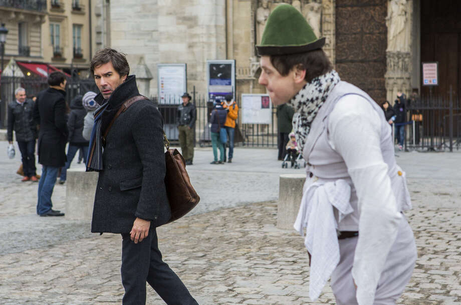 While on a dangerous mission in Paris, neuroscientist Daniel Pierce (Eric McCormack, left) tries to shake off a pesky street performer. Photo: TNT / San Antonio Express-News