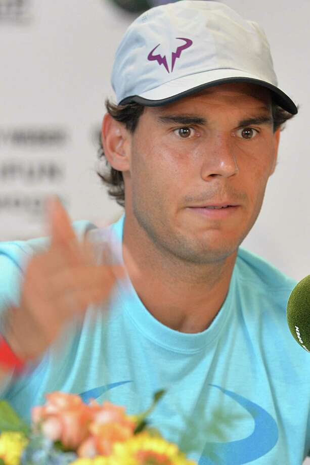 Spanish Rafael Nadal reacts during a press conference at the ATP Gerry Weber Open tennis tournament in Halle, western Germany on June 11, 2014.  AFP PHOTO / CARMEN JASPERSENCARMEN JASPERSEN/AFP/Getty Images ORG XMIT: - Photo: CARMEN JASPERSEN / AFP