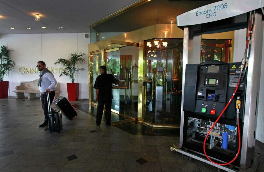 An Encore 700S CNG dispenser is displayed outside the Omni Houston Hotel on Thursday during the Natural Gas Vehicles USA Conference. Trucking officials say converting fleets to run on natural gas hasn't resulted in savings yet. Photo: Melissa Phillip, Staff / © 2014  Houston Chronicle