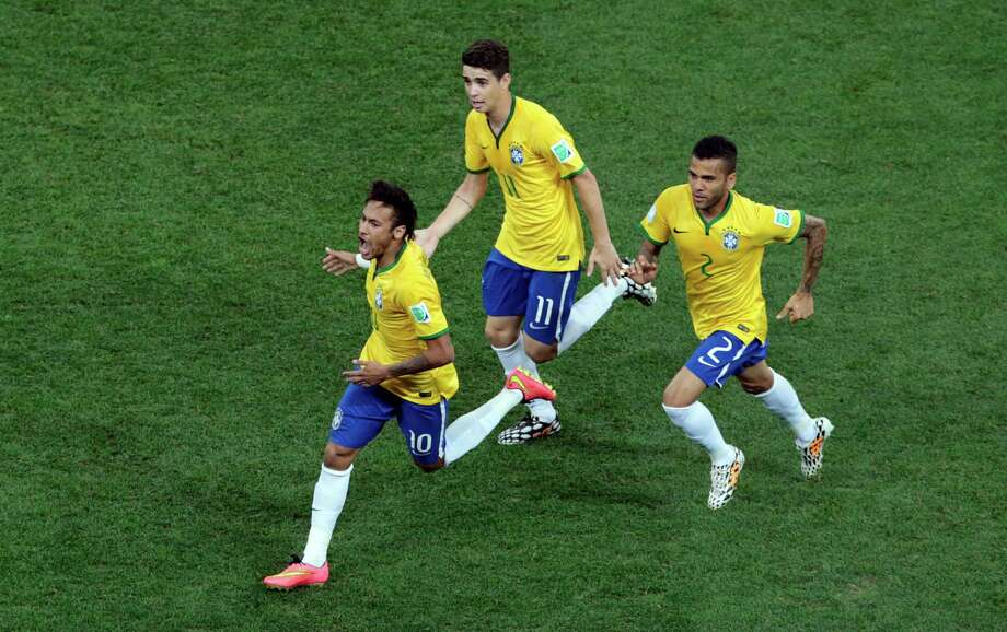 Brazil's Neymar, left, celebrates scoring his side's first goal during the group A World Cup soccer match between Brazil and Croatia, the opening game of the tournament, in the Itaquerao Stadium in Sao Paulo, Brazil, Thursday, June 12, 2014.  (AP Photo/Shuji Kajiyama) ORG XMIT: WCFO141 Photo: Shuji Kajiyama / AP