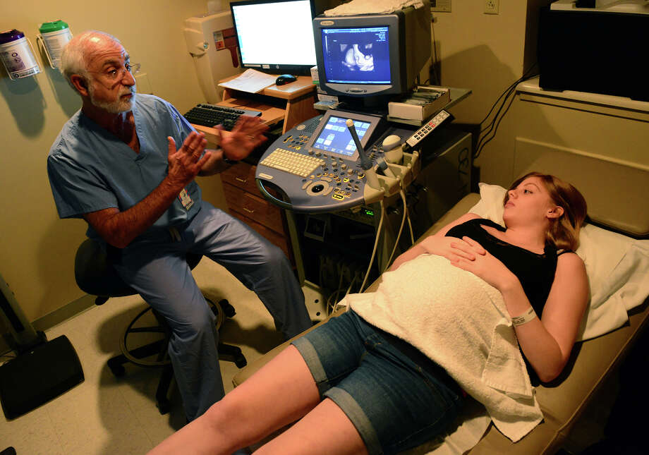 Dr. Robert Stiller goes over an ultrasound with his patient Toni Lombardi, of Fairfield, at Bridgeport Hospital in Bridgeport, Conn. on Thursday June 12, 2014. Traditionaly during pregnancy, a needle has been used to draw fluid from the womb to test for birth defects, in a procedure called amniocentesis. But now a simple blood test can be done instead to check for the same defects. Photo: Christian Abraham / Connecticut Post