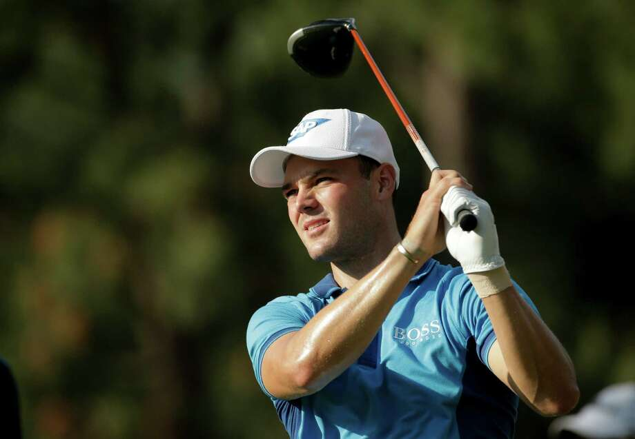 Martin Kaymer, of Germany, watches his tee shot on the 18th hole during the first round of the U.S. Open golf tournament in Pinehurst, N.C., Thursday, June 12, 2014. (AP Photo/Charlie Riedel) Photo: Charlie Riedel, Associated Press / Associated Press