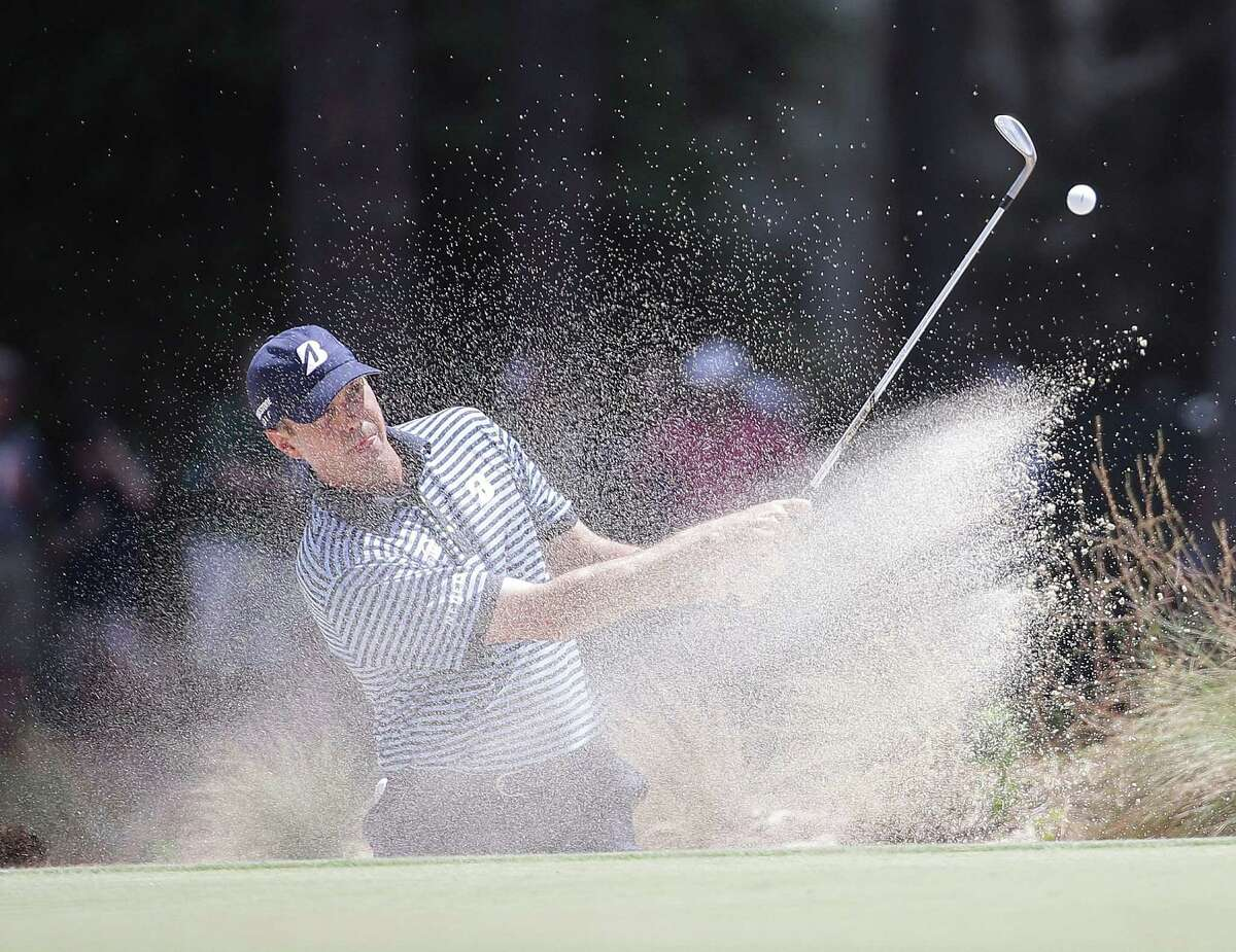 Matt Kuchar hits out of the bunker on the 17th hole during the first round of the U.S. Open golf tournament in Pinehurst, N.C., Thursday, June 12, 2014. (AP Photo/David Goldman)