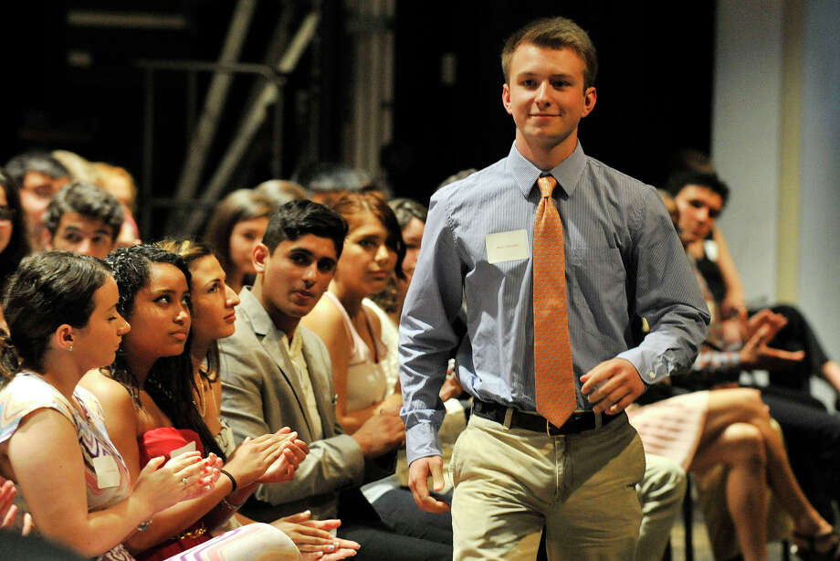 Mark Schmeiler walks across the stage to accept the Brian Thomas Macken Memorial Scholarship during the Greenwich Scholarship Association's annual scholarship awards ceremony at Greenwich High School in Greenwich, Conn., on Thursday, June 12, 2014. Photo: Jason Rearick / Stamford Advocate