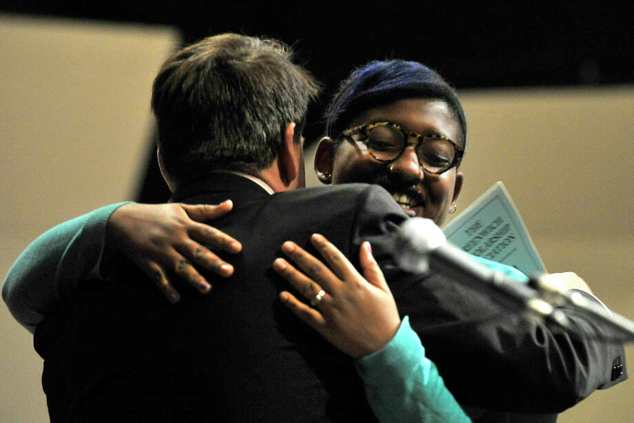 Greenwich Selectman Drew Marzullo hugs Alleyha Dannett after awarding her the Ketam Tamm Memorial Award during the Greenwich Scholarship Association's annual scholarship awards ceremony at Greenwich High School in Greenwich, Conn., on Thursday, June 12, 2014. Photo: Jason Rearick / Stamford Advocate