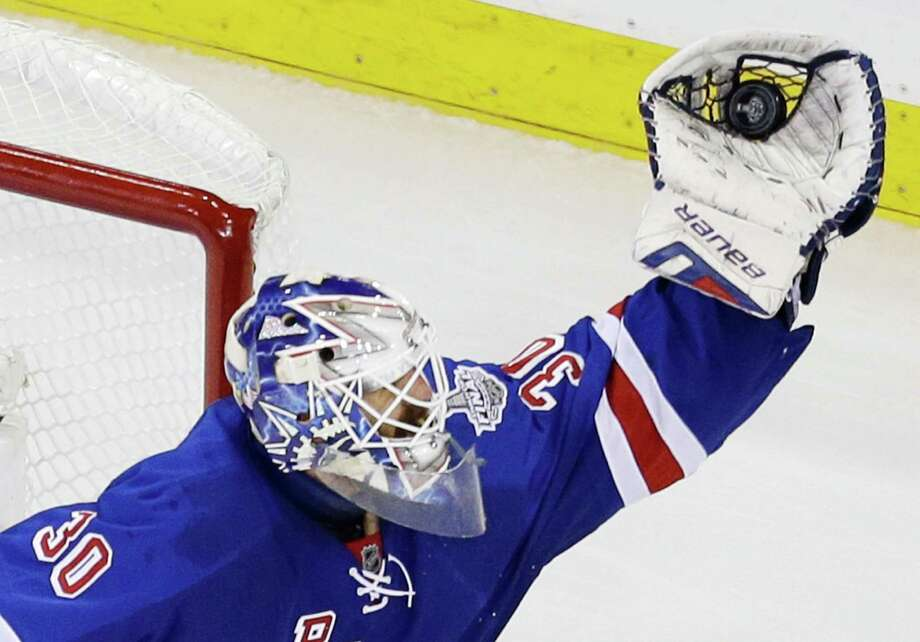 New York Rangers goalie Henrik Lundqvist (30) makes a save against the Los Angeles Kings in the third period during Game 4 of the NHL hockey Stanley Cup Final, Wednesday, June 11, 2014, in New York. The Rangers won the game 2-1. (AP Photo/Seth Wenig)  ORG XMIT: MSG149 Photo: Seth Wenig / AP