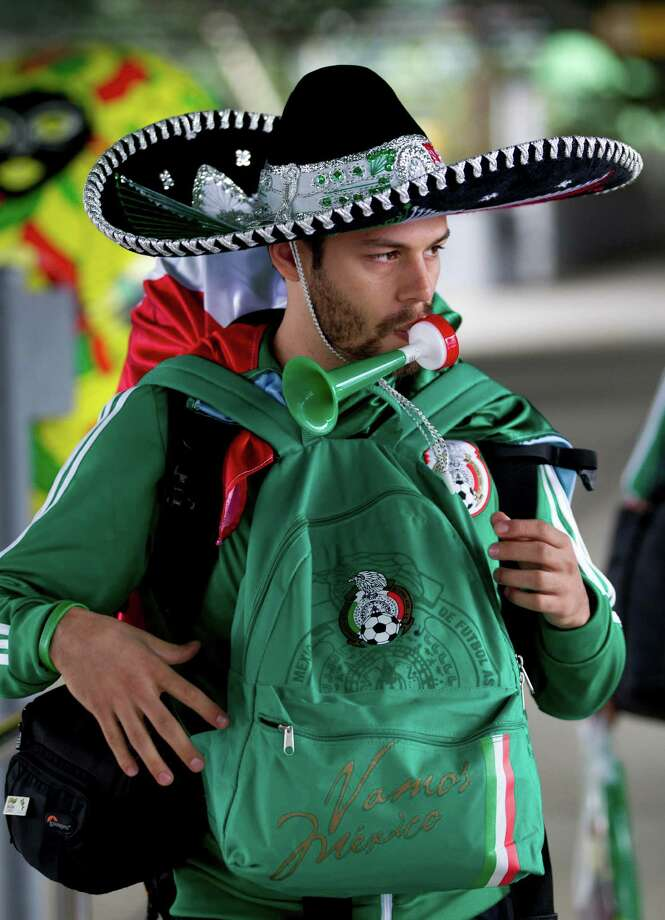 A Mexican soccer fan wearing a sombrero walks through the Guarulhos International Airport, after arriving from Mexico, in Sao Paulo, Brazil, Tuesday, June 10, 2014. Brazil will play the opening match against Croatia in Sao Paulo, Thursday. (AP Photo/Eduardo Verdugo) Photo: Eduardo Verdugo, STF / AP