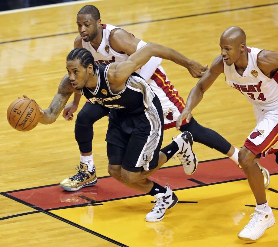 San Antonio Spurs' Kawhi Leonard looks for room between Miami Heat's Dwyane Wade (left) and Ray Allen during first half action in Game 4 of the 2014 NBA Finals Thursday June 12, 2014 at American Airlines Arena in Miami, Fla. Photo: Edward A. Ornelas, San Antonio Express-News