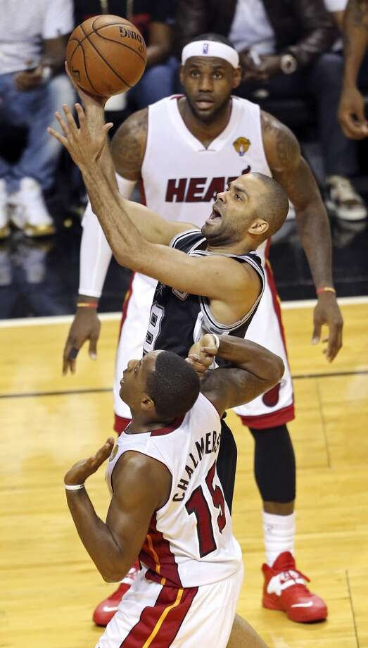 San Antonio Spurs' Tony Parker shoots over Miami Heat's Mario Chalmers as LeBron James looks on during first half action in Game 4 of the 2014 NBA Finals Thursday June 12, 2014 at American Airlines Arena in Miami, Fla. Photo: Edward A. Ornelas, San Antonio Express-News