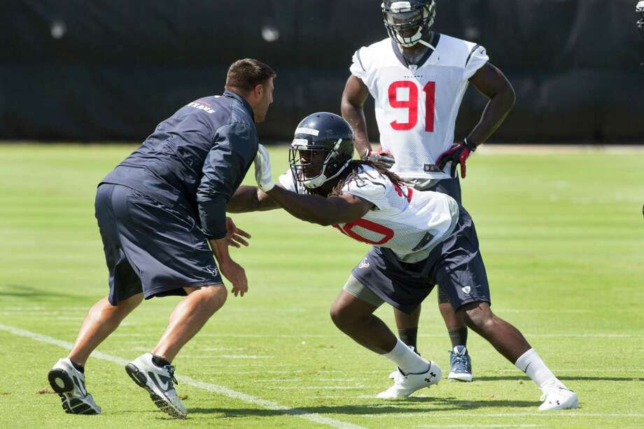 NFL Network analyst Willie McGinest likes the way top draft pick Jadeveon Clowney (90) is being groomed by Texans linebackers coach Mike Vrabel, left. Photo: Brett Coomer, Staff / © 2014 Houston Chronicle