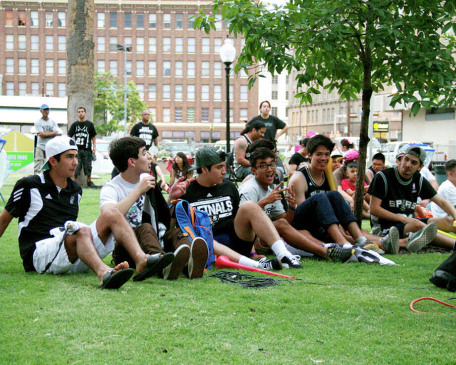 Fans gathered at Travis Park to watch their Spurs take on Miami during Game 4 of the NBA Finals on Thursday. Photo: 0320412472, By DeAnne Cuellar, For MySA.com