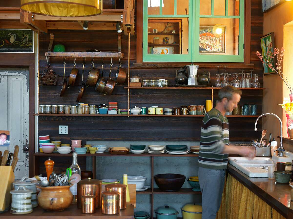 Gaétan Caron's kitchen is designed to look like the exterior of an old European building. Caron, co-owner of Lost Art Salon in San Francisco, lives off the grid in a custom house in the rolling hills west of Ukiah.