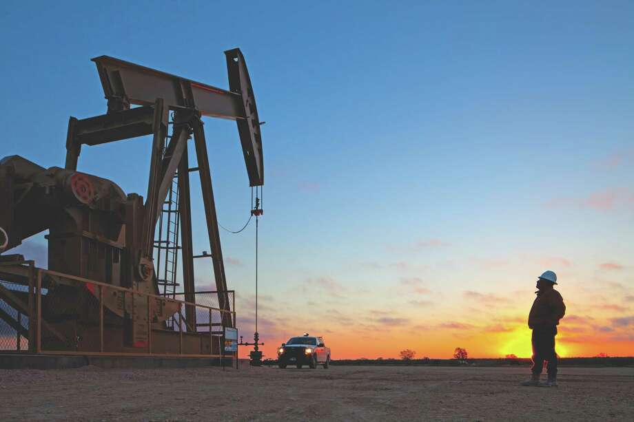 Production keeps growing in West Texas'  Permian Basin, site of this pumping operation for  Houston-based  EOG Resources. (EOG photo) Photo: Ken Childress Photography / ONLINE_YES