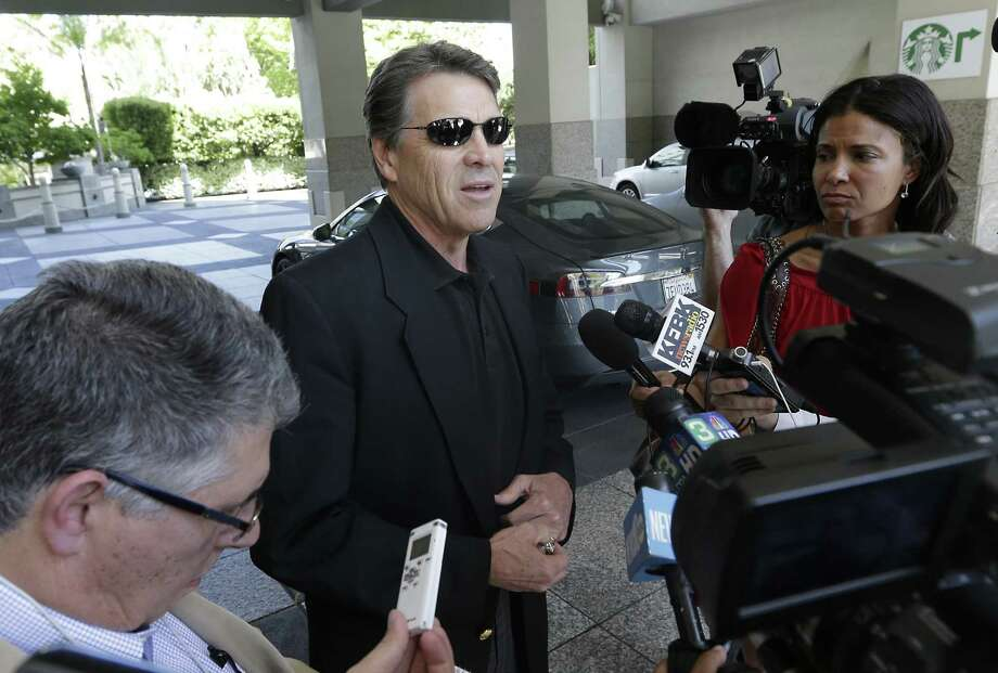 During his California visit, Texas Gov. Rick Perry drove a Tesla Motors Type S electric car to a meeting in Sacramento with GOP officials from the Golden State. Photo: Rich Pedroncelli / Associated Press / AP