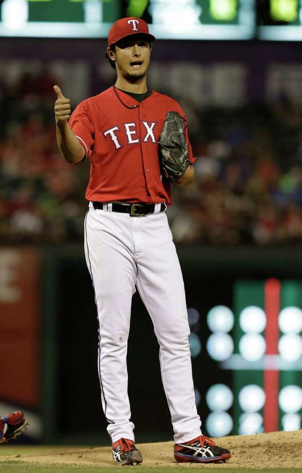 Texas Rangers starting pitcher Yu Darvish, of Japan, looks to his dugout during the baseball game against the Miami Marlins in Arlington, Texas, Wednesday, June 11, 2014.  (AP Photo/LM Otero) Photo: LM Otero, STF / AP