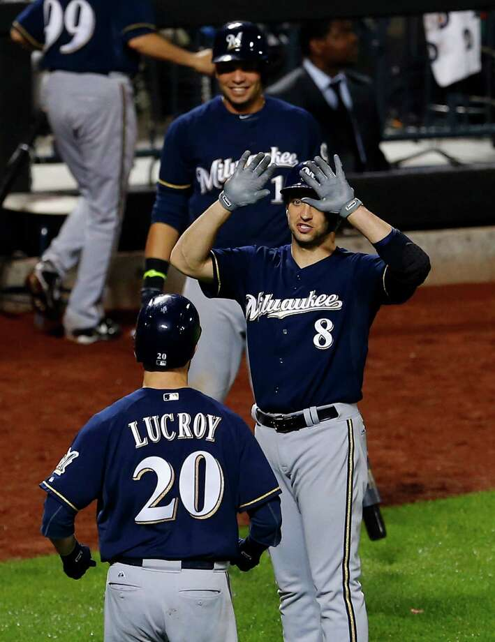 NEW YORK, NY - JUNE 12:  Jonathan Lucroy #20 of the Milwaukee Brewers is congratulated by teammates Ryan Braun #8 and Aramis Ramirez #16 after hitting a two-run home run in the 13th inning against the New York Mets on June 12, 2014 at Citi Field in the Flushing neighborhood of the Queens borough of New York City. (Photo by Rich Schultz/Getty Images) ORG XMIT: 477584851 Photo: Rich Schultz / 2014 Getty Images