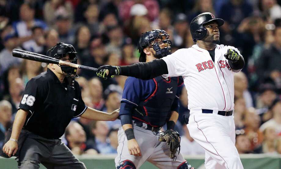 Boston Red Sox designated hitter David Ortiz, right, watches the flight of the ball on his two-run home run off Cleveland Indians starting pitcher Josh Tomlin during the fifth inning of a baseball game at Fenway Park in Boston, Thursday, June 12, 2014. (AP Photo/Charles Krupa) ORG XMIT: MACK112 Photo: Charles Krupa / AP