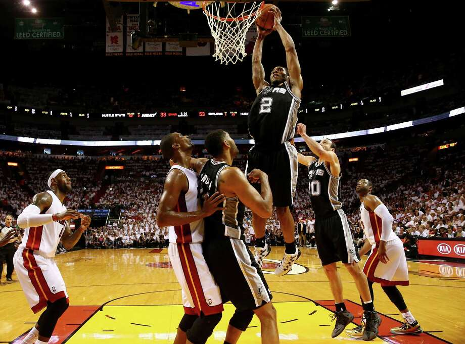 MIAMI, FL - JUNE 12:  Kawhi Leonard #2 of the San Antonio Spurs dunks against the Miami Heat during Game Four of the 2014 NBA Finals at American Airlines Arena on June 12, 2014 in Miami, Florida. NOTE TO USER: User expressly acknowledges and agrees that, by downloading and or using this photograph, User is consenting to the terms and conditions of the Getty Images License Agreement.  (Photo by Andy Lyons/Getty Images) ORG XMIT: 495643531 Photo: Andy Lyons / 2014 Getty Images