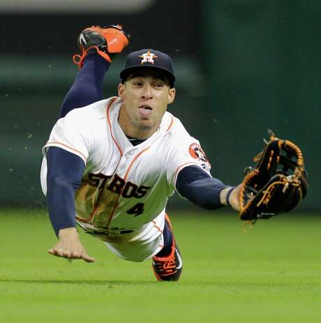 Right fielder George Springer goes horizontal to make a catch during the Astros' 5-4, 10-inning victory over the Diamondbacks on Thursday night. Photo: Bob Levey, Stringer / 2014 Getty Images