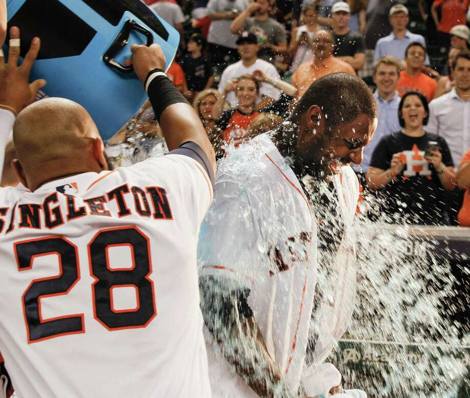 Jon Singleton gives Chris Carter, right, a shower after Carter slugged a walkoff homer in the 10th. Photo: Bob Levey, Stringer / 2014 Getty Images