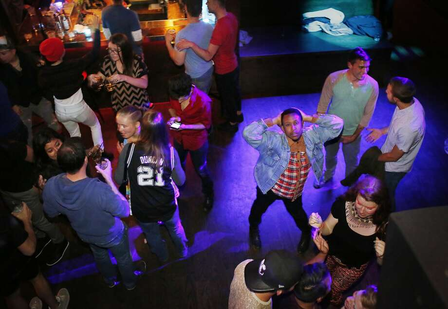 Above: Jocquese Whitfield vogue-dances at Beaux Castro Dance Club and Bar. Photo: Mike Kepka, The Chronicle