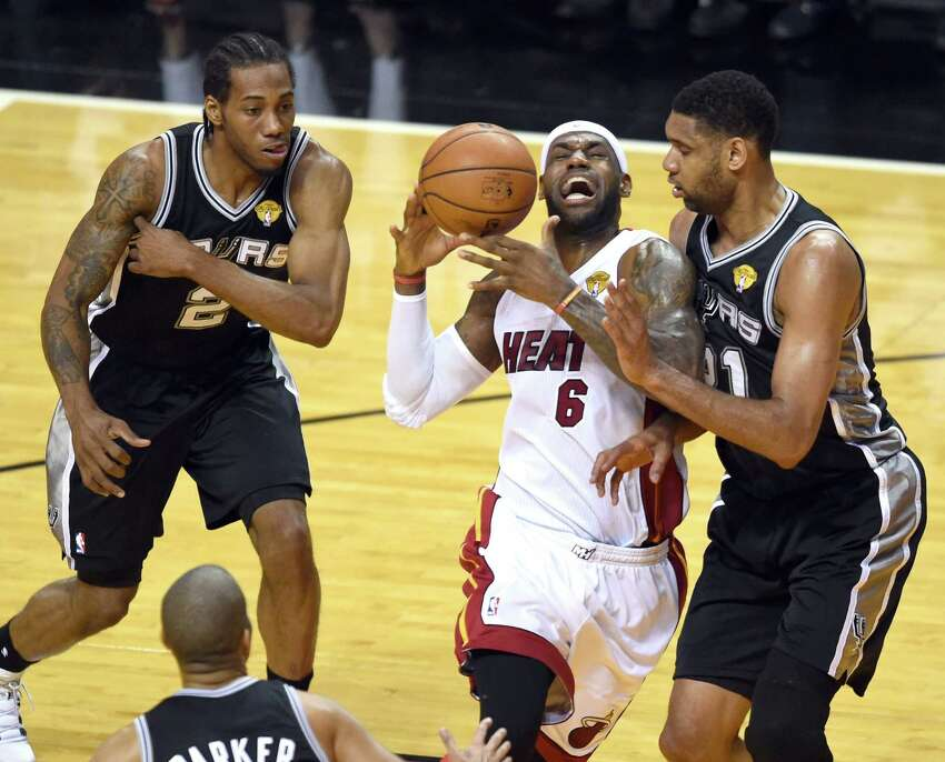 The Spurs are Tim Duncan's team - at least for one more year. Then it's arguably Tony's team with Kawhi Leonard playing a strong role. Would The King be able to share the stage? Would Tony and Kawhi be able to take a backseat?PHOTO: LeBron James is surrounded by Tim Duncan, Kawhi Leonard and Tony Parker during Game 4 of the NBA Finals on June 12, 2014, at the American Airlines Arena in Miami.