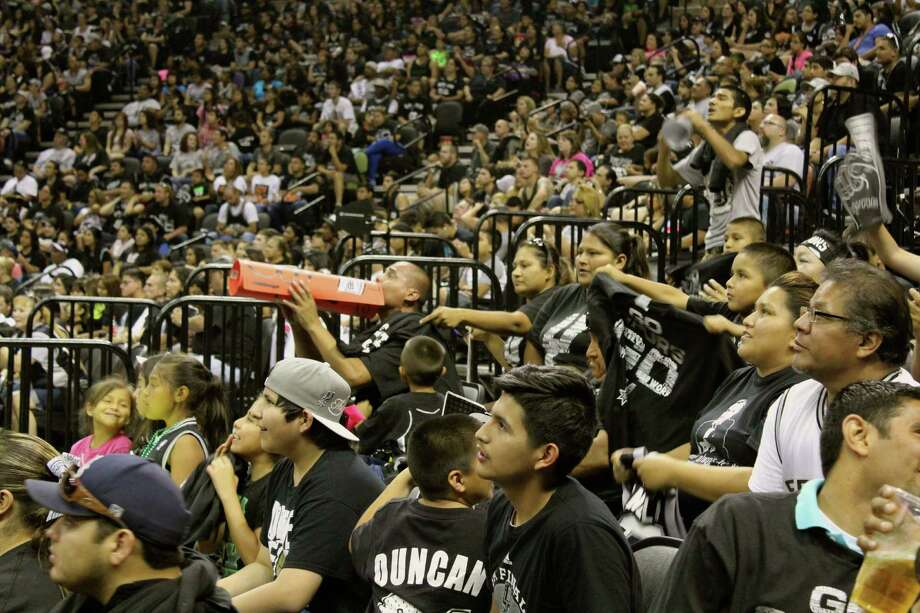 Fans packed the AT&T Center to watch the Spurs win Game 4 in Miami and get closer to the fifth NBA title for San Antonio. Photo: By Yvonne Zamora, For MySA.com