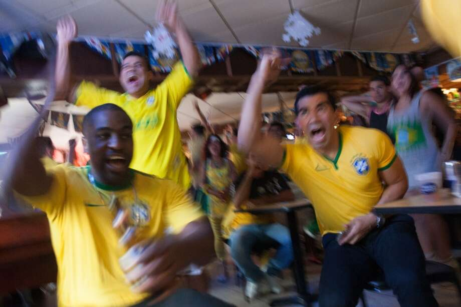 Brazil fans cheer after Brazil's first goal vs. Croatia in their World Cup opening match at the Old Oak in Danbury, CT. Photo: Douglas Zimmerman, Courtesy