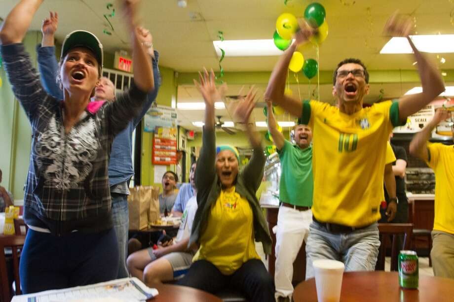 Brazil fans celebrate their team's third goal while watching the Brazil vs. Croatia World Cup opening match at the Banana Brazil restaurant on Main Street in Danbury, CT. Photo: Douglas Zimmerman, Courtesy