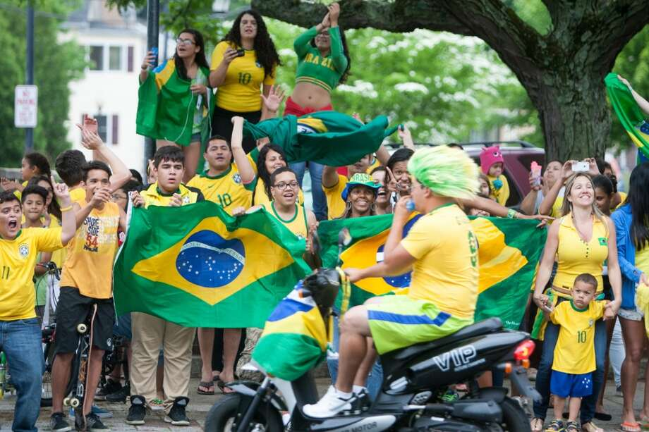 Brazil fans cheer while taking part in a impromptu parade down Main Street to celebrate Brazil's victory over Croatia in their World Cup opening match. Photo: Douglas Zimmerman, Courtesy